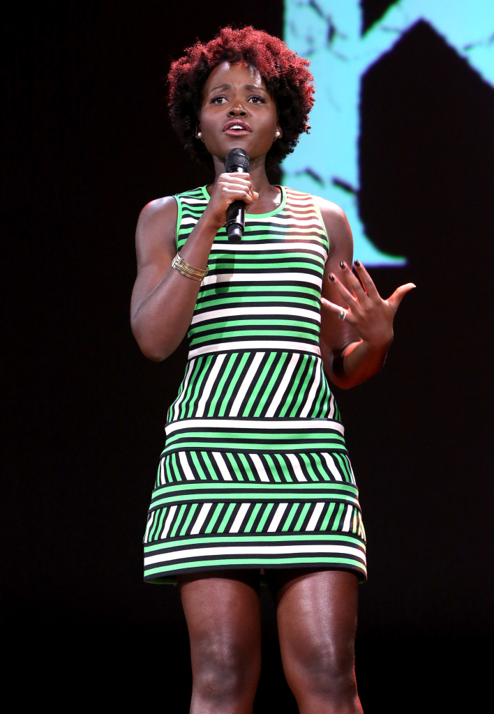 """ANAHEIM, CA - AUGUST 15:  Actress Lupita Nyong'o of QUEEN OF KATWE took part today in """"Worlds, Galaxies, and Universes: Live Action at The Walt Disney Studios"""" presentation at Disney's D23 EXPO 2015 in Anaheim, Calif.  (Photo by Jesse Grant/Getty Images for Disney) *** Local Caption *** Lupita Nyong'o"""