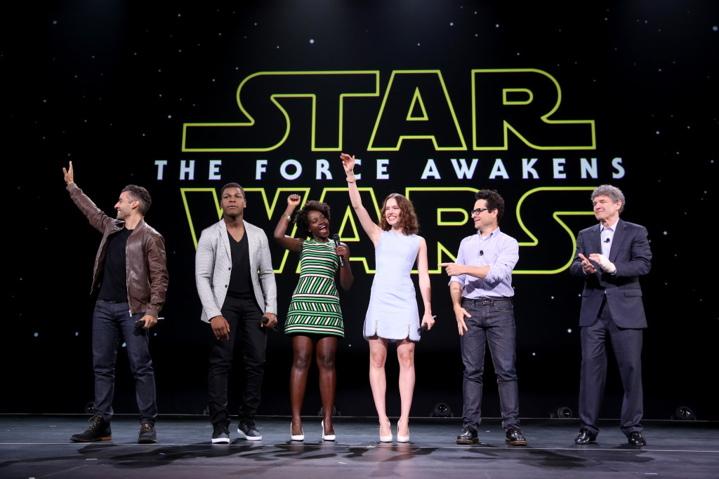 """ANAHEIM, CA - AUGUST 15: (L-R) Actors Oscar Isaac, John Boyega, Lupita Nyong'o, Daisy Ridley, director J.J. Abrams of STAR WARS: THE FORCE AWAKENS and Chairman of the Walt Disney Studios Alan Horn took part today in """"Worlds, Galaxies, and Universes: Live Action at The Walt Disney Studios"""" presentation at Disney's D23 EXPO 2015 in Anaheim, Calif. (Photo by Jesse Grant/Getty Images for Disney) *** Local Caption *** Oscar Isaac; John Boyega; Lupita Nyong'o; Daisy Ridley; J.J. Abrams; Alan Horn"""